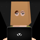 Girl with a bag in her head holding a Laptop