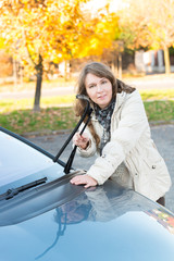 Woman picking up windscreen wiper