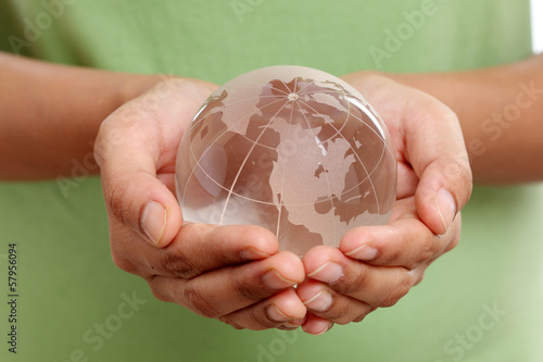 Closeup of glass globe in woman hands