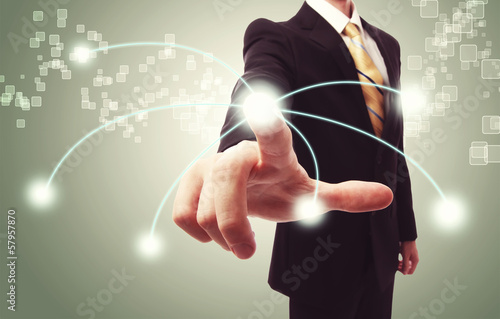 Businessman pressing technology button