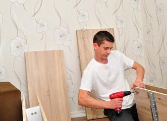 Family man assembling furniture.