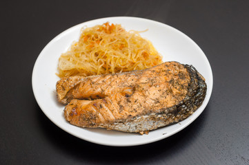Salmon steak served with funchoza noodles