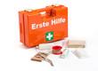Leinwandbild Motiv Erste Hilfe Koffer mit Verbandmaterial