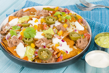 Nachos - Cheesy tortilla chips with toppings.