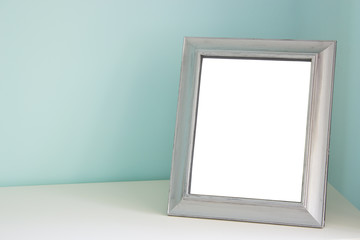 Blank picture frame at the desk
