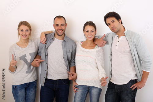 Group of smiling friends hanging around