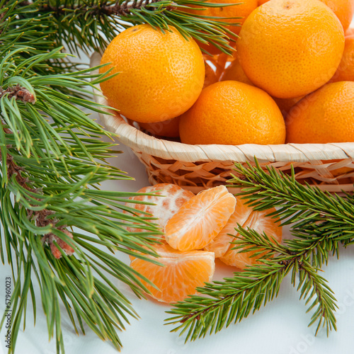 Christmas decoration with mandarin and pine branches
