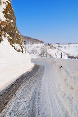 dangerous road in winter with snow and ice