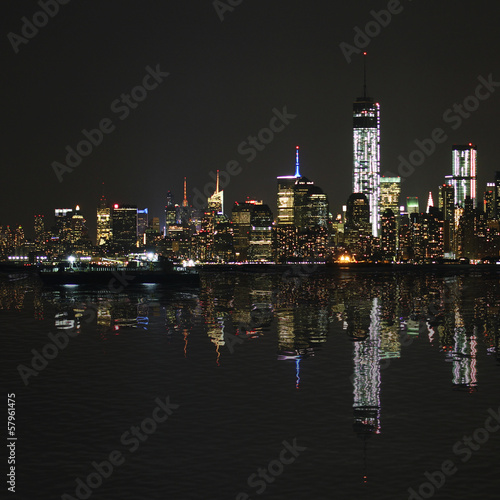 Manhattan at night, New York City skyline with reflection