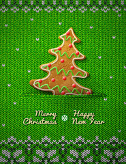 Christmas tree gingerbread cookie on knitted background