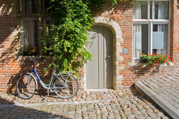Leuven - Bicycle in front of brick house