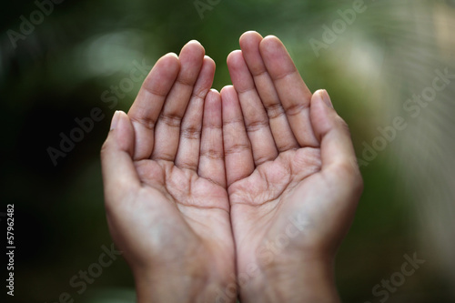 Closeup view of praying hands