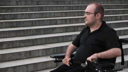 paralyzed man portrait approaching a staircase barrier looking a