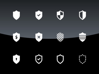 Shield icons on black background.
