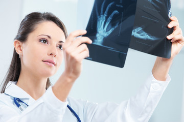 Female doctor examing an x-ray