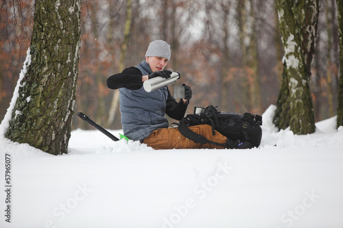 winter hiker having break for cup of tea