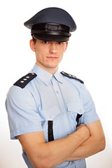 Portrait of young policeman on white background.