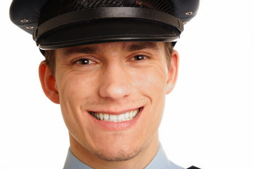 Portrait of smiling young policeman close up.