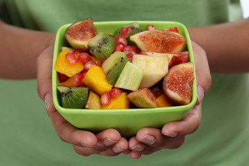 Fruit salad in the hands