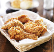 fried chicken pile in a basket on table