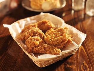 fried chicken basket in golden light