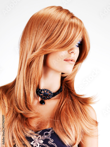 Beautiful woman with long red hairs