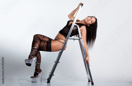Beautiful woman with lingerie on a ladder