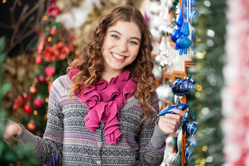 Cheerful Woman Shopping For Christmas Ornaments