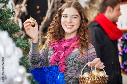 Beautiful Woman Shopping Ornaments At Christmas Store