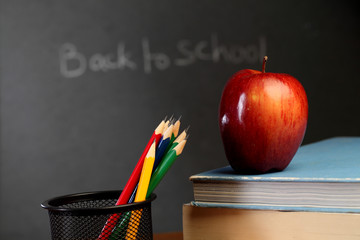 Red apple against black board