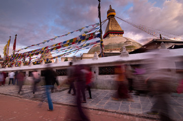 People walking around Boudhanath Stupa. Nepal