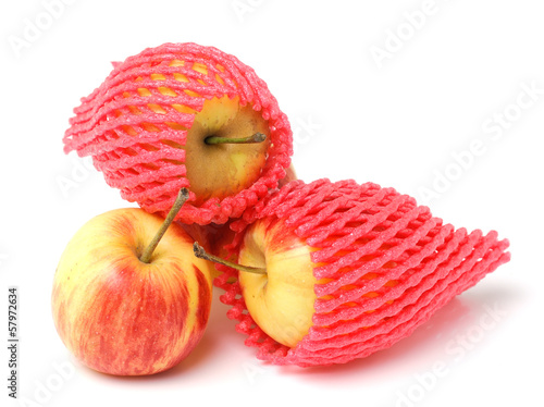 apple in a foam mesh sleeve, isolated on white