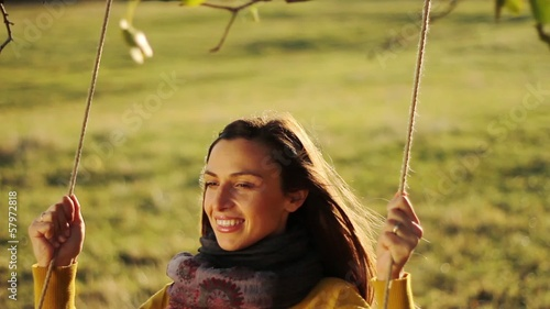 Beautiful Young Female Model Long Hair Fun Swing Smile Nature