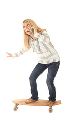 Woman balancing on a long board talking on phone
