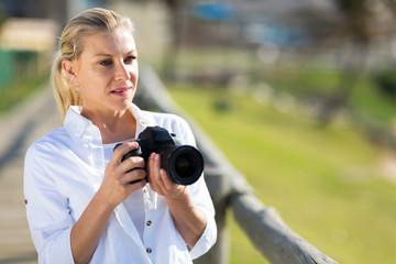 thoughtful amateur photographer holding camera