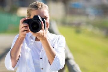 mature female photographer taking photos