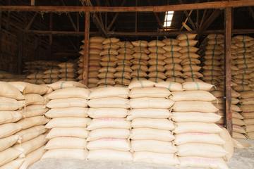 Stack hemp sacks of rice