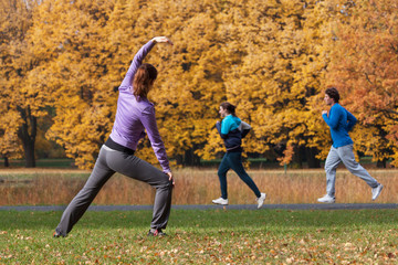 Young people exercising in park