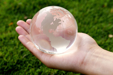 Hand holding a glass globe