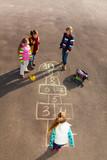 Fototapety Kids play hopscotch