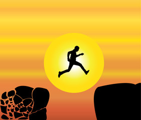 Success man jumping crumbing mountain rock bright orange sky sun