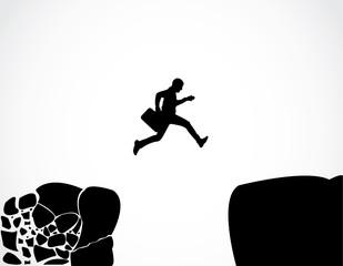Business man jump crumbing rock reach safety risk success