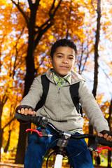 Happy black boy ride a bike