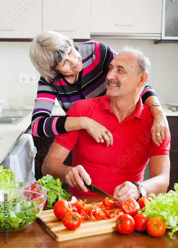 married mature couple cooking together