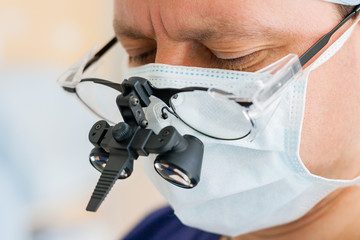 Surgeon with binocular glasses