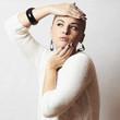 Beautiful woman in white woolen dress.Jewelry and Beauty.winter