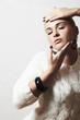 Beautiful woman in white woolen dress.liquid sand manicure