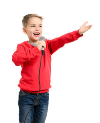 Little boy with microphone sings a song