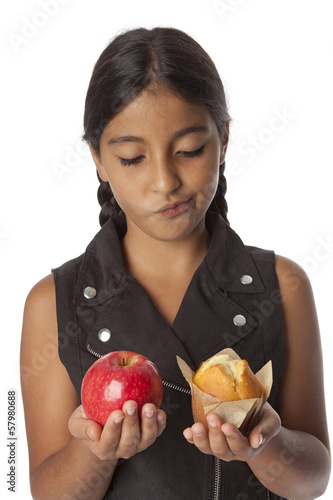 Young teenage girl with an apple and a muffin