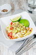 Zucchini noodles with tomatoes, avocado and lime